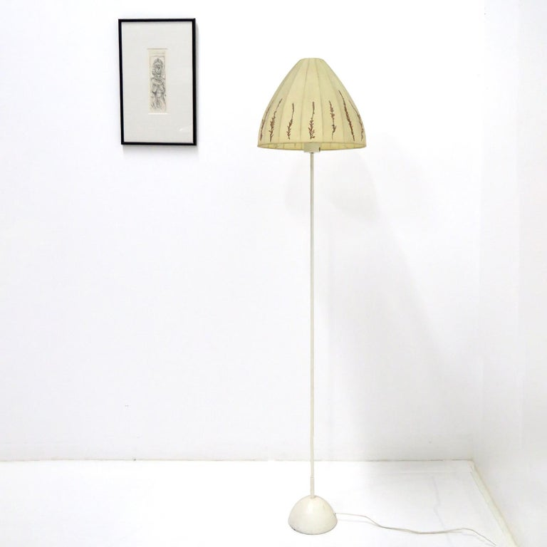 Wonderful floor lamp by Hans-Agne Jakobsson for Markaryd, Sweden, 1960, fabric shade with floral applications on an enameled metal base, wired for US standards, one E27 socket, max. wattage 75w, bulb provided as a onetime courtesy, marked with