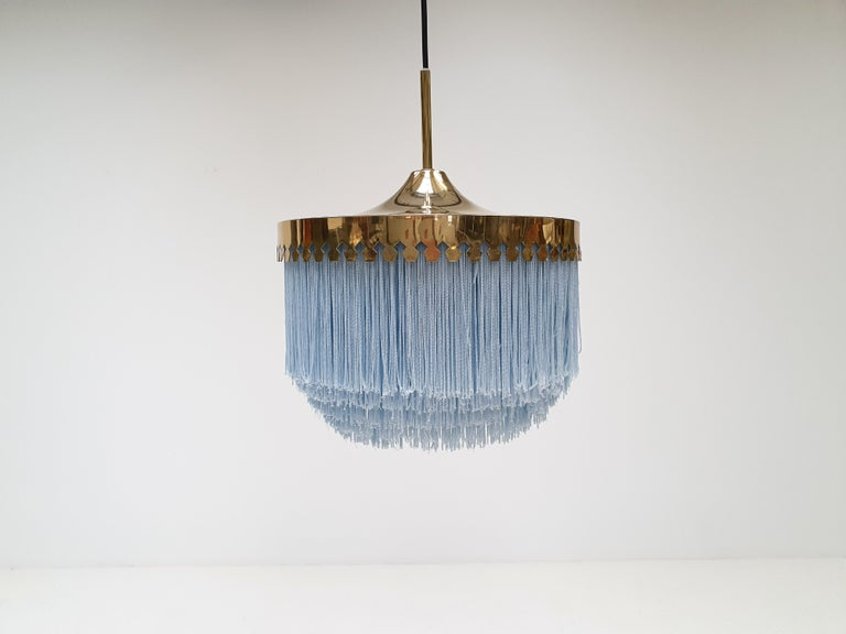 A Hans-Agne Jakobsson for Markaryd brass and ivory silk fringe model T601/M pendant, 1960s   A Hans-Agne Jakobsson for Markaryd golden champagne colored silk fringed pendant with brass frame, dating from the 1960s.  Fully working, rewired,