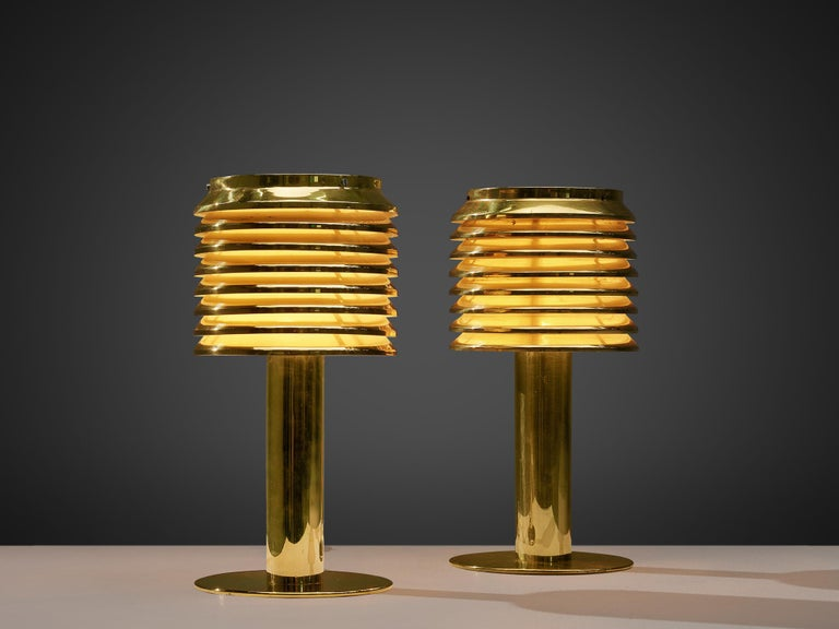 Hans-Agne Jakobsson, pair of table lamps model B-142, brass, Sweden, 1960s  Luxurious pair of table lights, designed by the Swedish master of light Hans-Agne Jakobsson. This model, called B-142, features a brass foot that holds a brass shade. The
