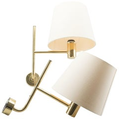 Hans-Agne Jakobsson Pair of Brass Wall Lights with Cream Shades