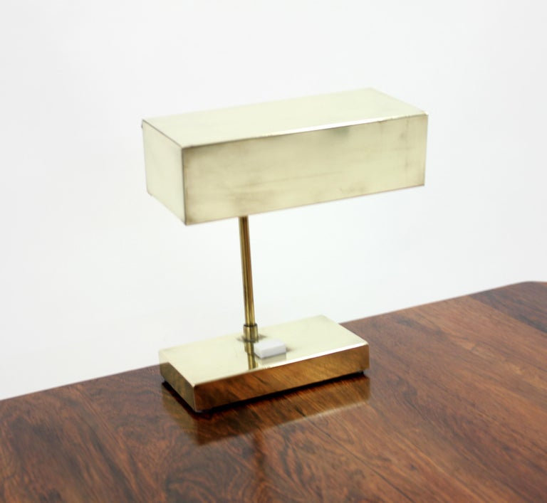 Model 2201 brass table lamp by Hans-Agne Jakobsson for Elidus. Marked by the maker under the foot. Adjustable shade that can be moved up and down. Original white plastic screen under the shade. Very good vintage condition with a small damage on one