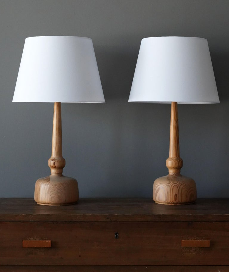 A table lamp designed and produced by Hans-Agne Jakobsson, Markaryd, Sweden, 1970s.   Sold without lampshades. Stated dimensions exclude lampshade.  Other designers of the period include Paavo Tynell, Hans Bergström, Josef Frank, Alvar Aalto,