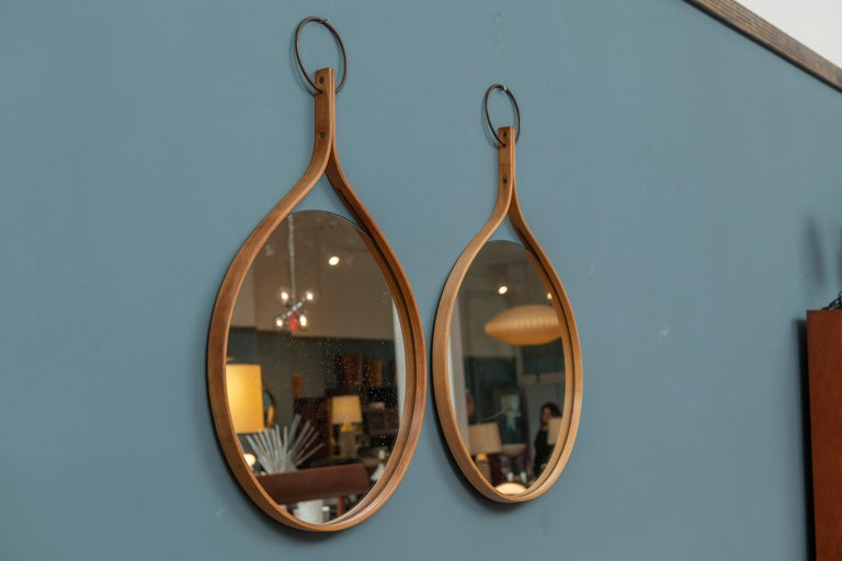 Pair of Hans-Agne Jakobsson wall mirrors, circa 1955. A beautiful bentwood design in good original condition.