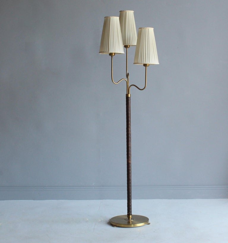 A rare floor lamp with 3 organic arms, designed by Hans Bergström in 1946. Produced by ASEA. 