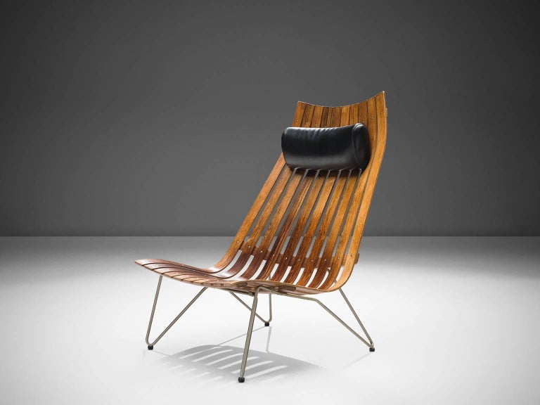 Hans Brattrud for Hove Mobler, lounge chair model 'Scandia' in rosewood and metal, Norway, circa 1957.   This chair was part of the Scandia series, designed by Norwegian designer Hans Brattrud and produced by Hove Mobler. The chair is executed in