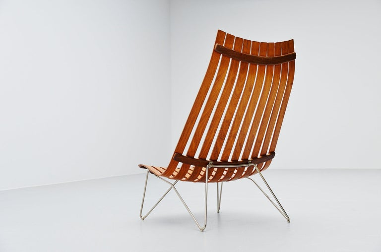 Fantastic low lounge chair model Scandia designed by Hans Brattrud and manufactured by Hove Mobler, Norway, 1957. This chair was made of several plywood veneered slats, rosewood finished and has a chrome-plated solid metal base. The chair comes from