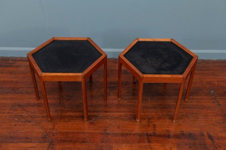 Hans C Andersen design teak hexagonal side or drink tables with black laminate tops, for Arturo Denmark, 1960s.
