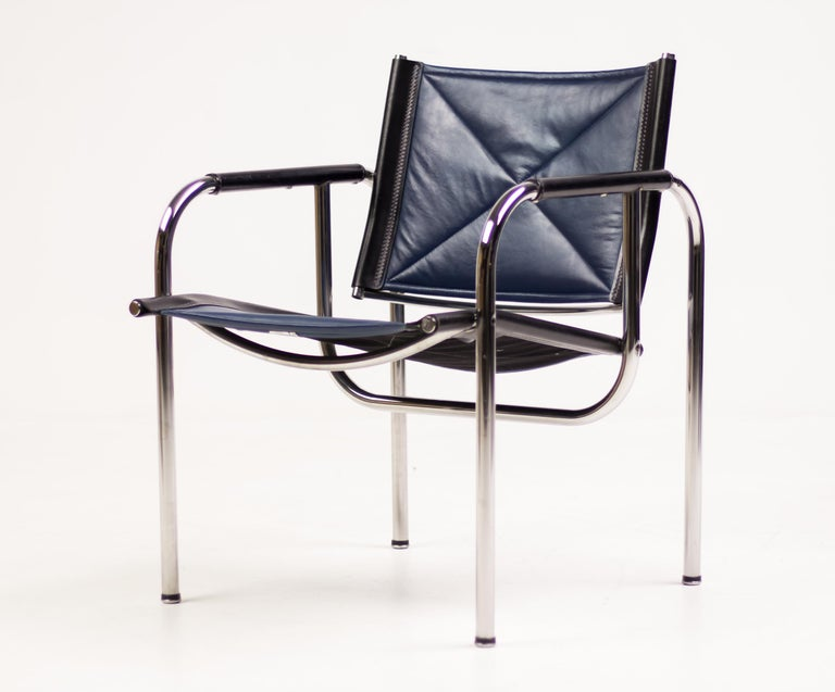 Set of four Hans Eichenberger chromed tubular steel and blue leather lounge chairs with tilting back by Strässle, Switzerland.  Very comfortable modernist chairs in great vintage condition. Marked with silver foil label. Priced as a set.