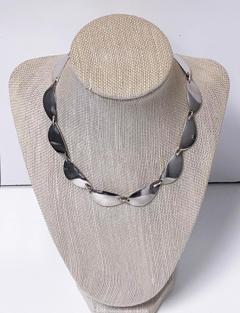 Hans Hansen sterling silver necklace Denmark C. 1968, The necklace with tear drop polished link design hook fitment. Signed and numbered 318. Length 15.25 inches. Item weight: 49.01 grams.