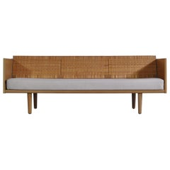 "Hans J. Wegner 1950s Danish Modern Daybed in Oak and Rattan ""GE7"" Made at GETAMA"