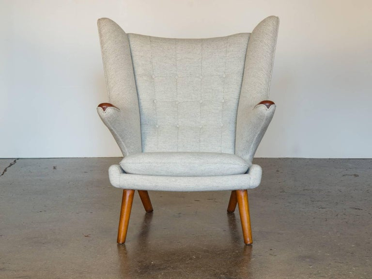 Papa Bear chair and ottoman, designed by Hans J. Wegner and made by AP Stolen, this stunning early 1960s teak AP-19 chair and ottoman have been lovingly refinished, and upholstered in Nanna Ditzel's Hallingdal fabric. Both pieces are stamped.