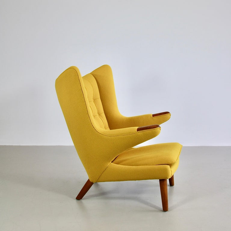 The Bamsestol (bear chair), known as the PAPA BEAR lounge chair designed by Hans J. Wegner. Denmark, A.P. Stolen, 1951.  Original edition. Solid wooden construction with oak paws and new yellow Kvadrat upholstery. A very good vintage chair with