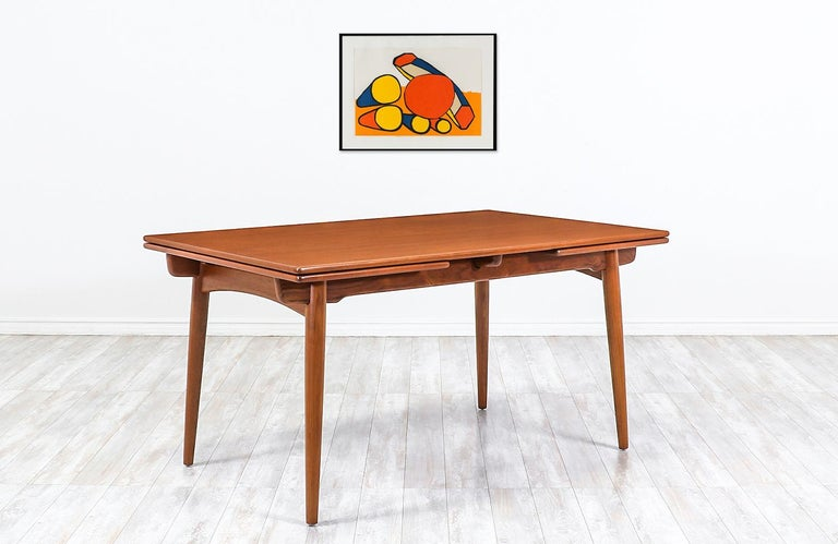 Hans J. Wegner AT 312 teak draw-leaf dining table for Andreas Tuck   Dimensions: 28.50in H x 55in W - 94in W x 35.50in D Each extension leaf 19.50in.