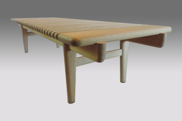 One of the most beautifully handcrafted solid timber benches ever designed.  Designed by Hans J. Wegner in 1953 for Johannes Hansen. This piece was manufacture red in the 1970s and has the original manufacturer's sticker is on the underside. It was