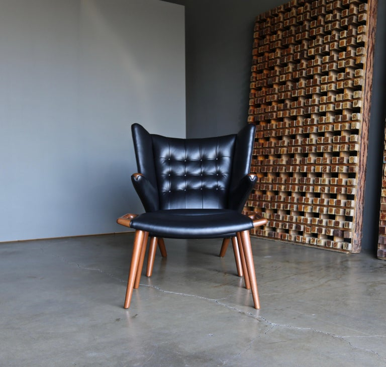 Hans J. Wegner black leather Papa Bear chair and ottoman for A.P. Stolen circa 1950. This piece has been professionally restored. 