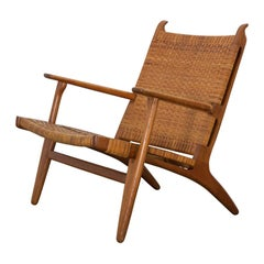 Hans J. Wegner CH-27 Oak Lounge Chair with Woven Rattan Seat