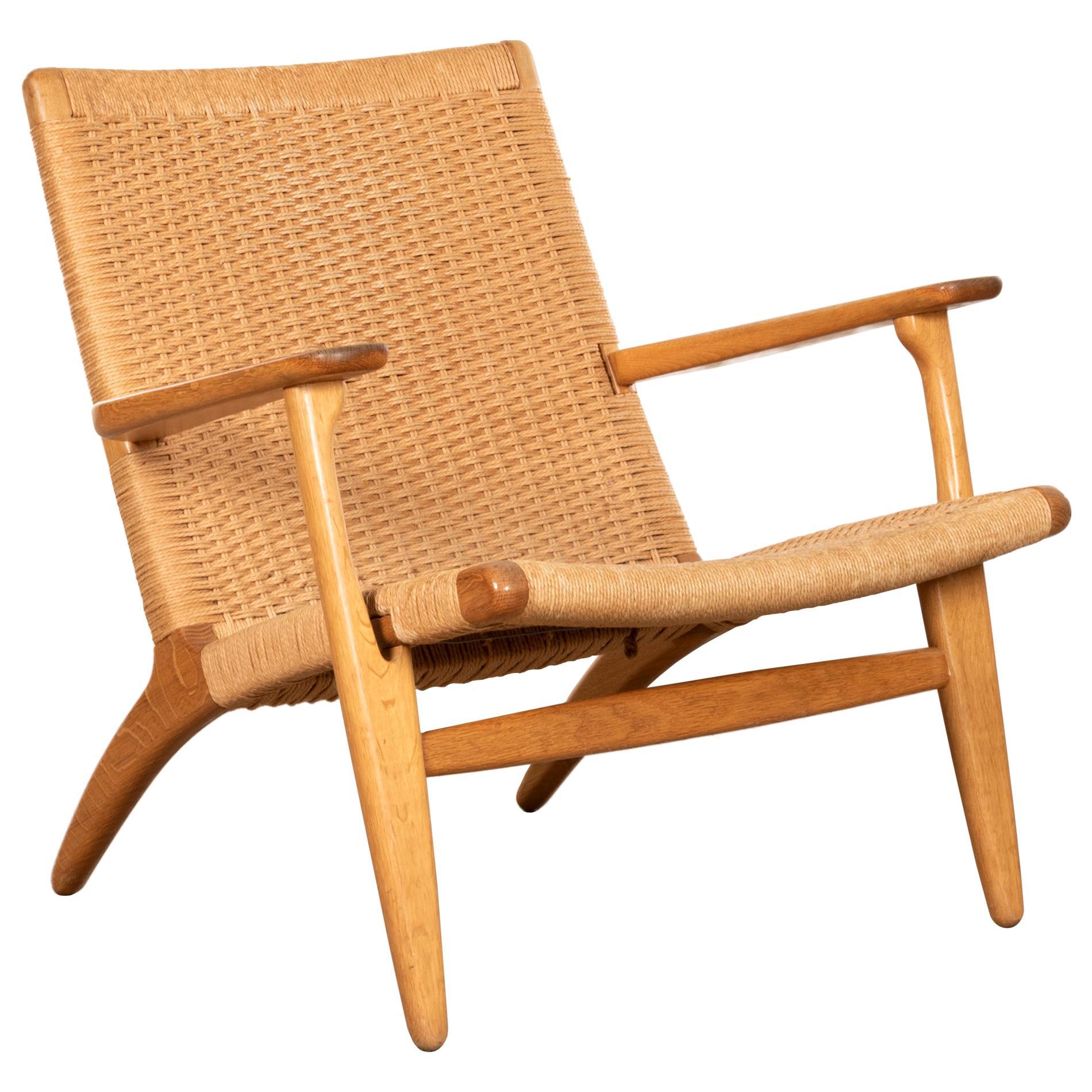 Hans J. Wegner CH25 Lounge Chair in Oak and Naturel Cord for Carl Hansen & Søn
