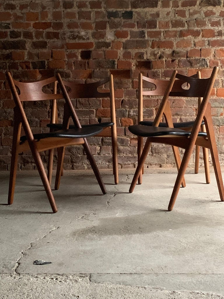 Midcentury Danish Hans J Wegner design CH-29 Sawbuck chairs by Carl Hansen & Son circa 1950s, the chairs have been full restored and are finished in teak.   Condition report: The chairs have been completely restored and re-polished and offered in