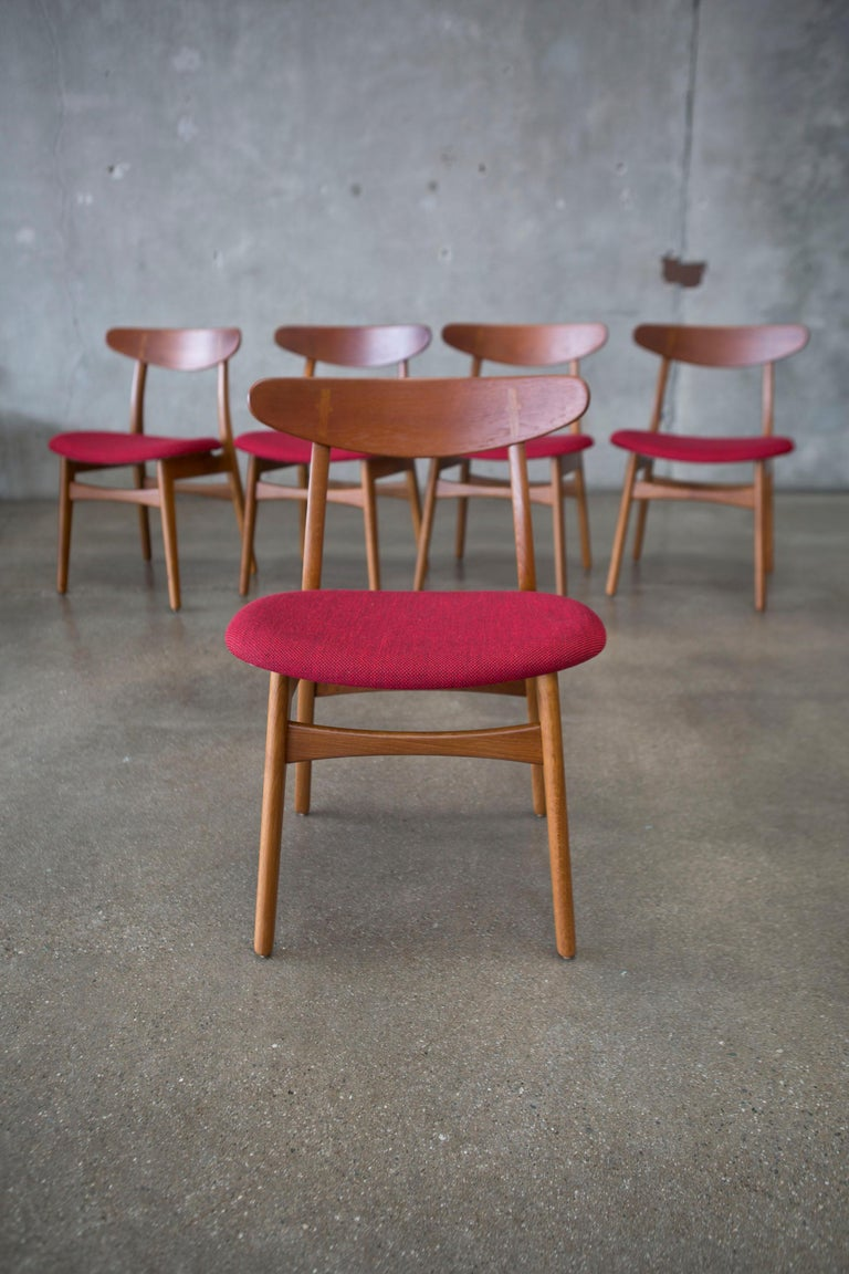 Hans J. Wegner CH30 chairs in teak and oak set of five, Denmark, 1950s  The straight forward design has become an iconic Classic. The exposed joint between the backrest and rear post is a feature seen in other Wegner pieces and is a testament to