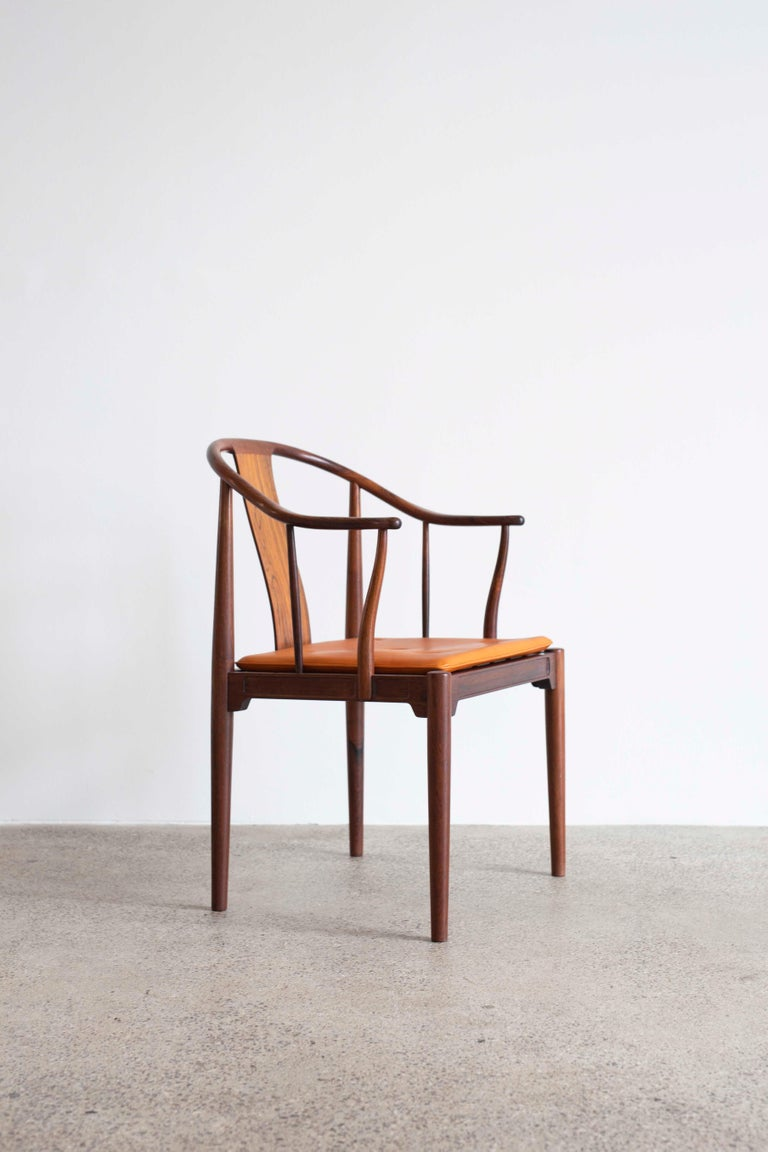 Hans J. Wegner China chair in Brazilian rosewood with leather cushion.