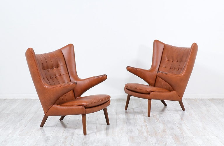 """These iconic """"Papa Bear"""" lounge chairs were designed by Hans J. Wegner for the famous Danish workshop of A.P. Stolen in 1951. Originally named the AP-19, this model acquired the name """"Papa Bear"""" when a journalist claimed that the chair looked like a"""