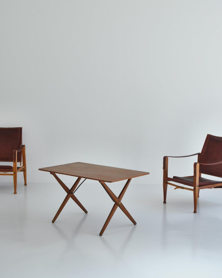 Original 1950s Hans J. Wegner coffee or side table made at cabinetmaker Andreas Tuck, Denmark. The table top is made from teakwood and the base is patinated oak. Beautiful brass details. Stamped underneath by maker.