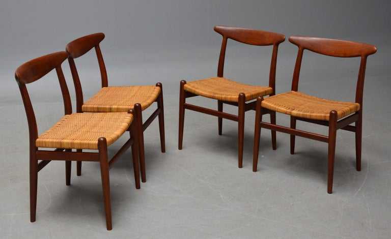 Hans J. Wegner 1914-2007. A set of four teak chairs and patinated wicker. Produced by C.M. Madsen 1960s with stamp from here. Model W2, Rare offered model. Well-maintained with minimal traces of use age taken into account.