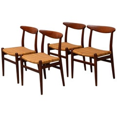 Hans J. Wegner, Dining Chairs Model W2 'Set of 4', Teak and Patinated Wicker