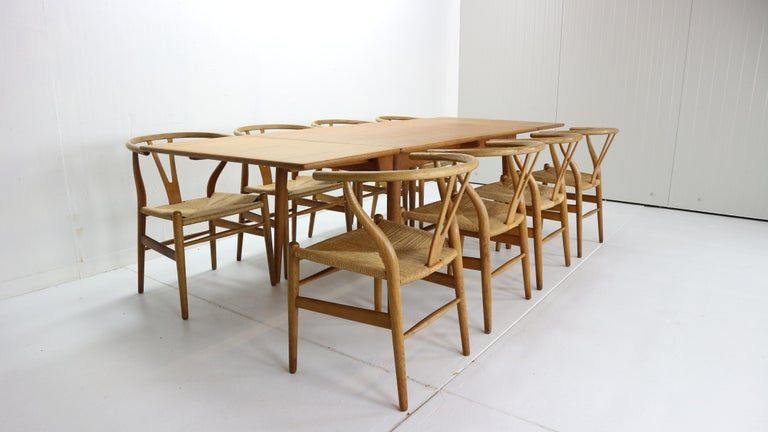 Scandinavian Modern period dinning room set (dinning table and 8 dinning chairs) designed by Hans J. Wegner in 1950s period, Denmark.  Extendable dinning room table Model no. AT-312 manufactured for Andreas Tuck.  Made entirely of oak wood, with
