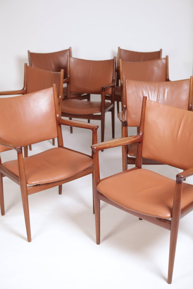 A set of eight Hans Wegner JH513 armchairs in solid mahogany and leather.