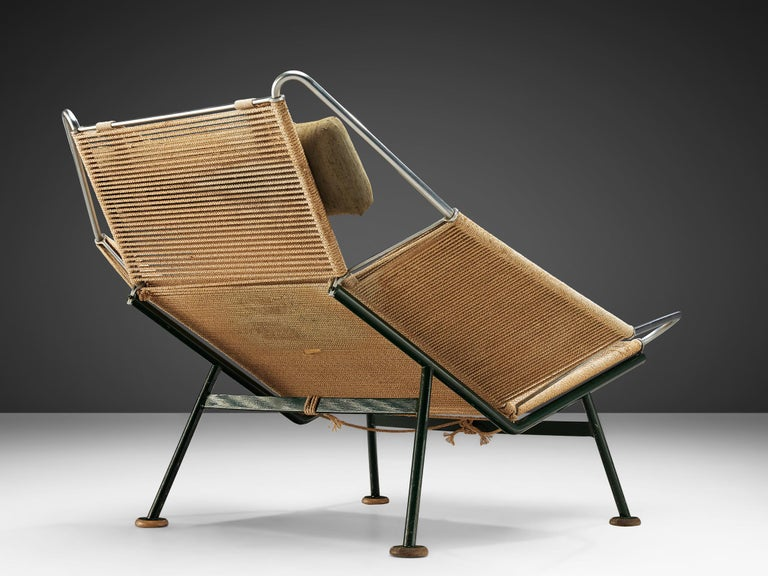 Hans Wegner, Flag Halyard chair GE225, rope, dark green lacquered steel, Denmark, 1950.  This iconic chair, made with 250 meter of rope, is designed by Hans Wegner. The name Flag Halyard simply comes from the innovative material with which Wegner