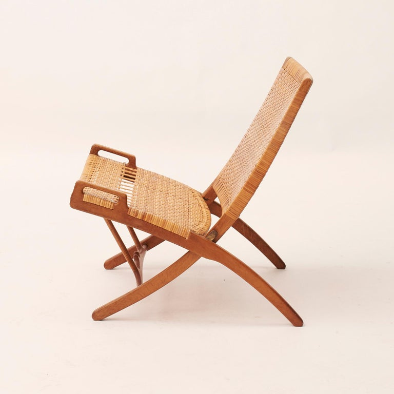 Hans J. Wegner 1914-2007. Model HJ512, 'Kaminstol'. Folding chair in oak, woven cane seat and back. Designed in 1949. Produced by Johannes Hansen, Model JH-512. The model was presented at The Copenhagen Cabinetmakers' Guild Exhibition at