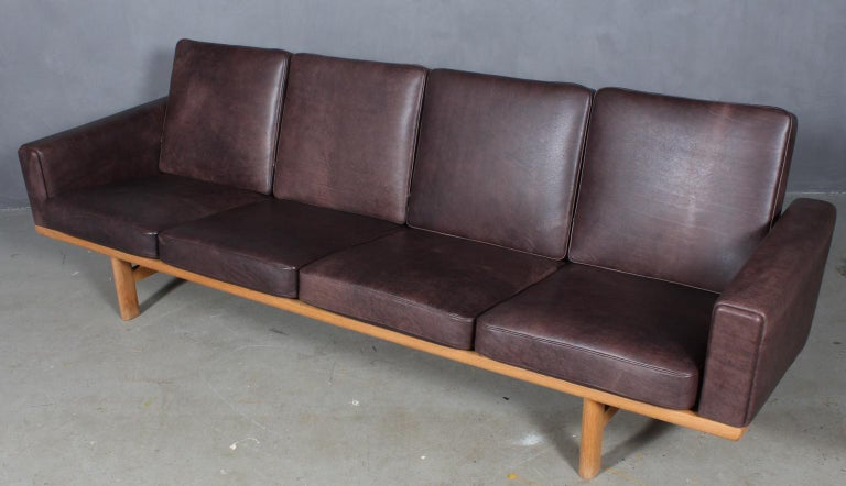 Hans J. Wegner four-seat sofa new upholstered with mokka aniline leather.