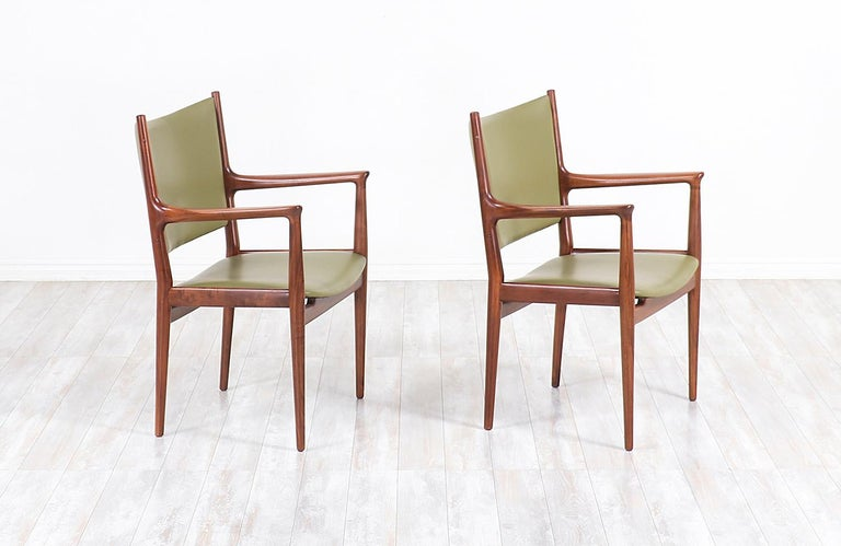 Pair of JH-509 armchairs designed by iconic Danish furniture designer Hans J. Wegner for Johannes Hansen in Denmark, circa 1950s. Initially designed for conference and meeting rooms, these ergonomic chairs showcase Wegner's superior design ideals
