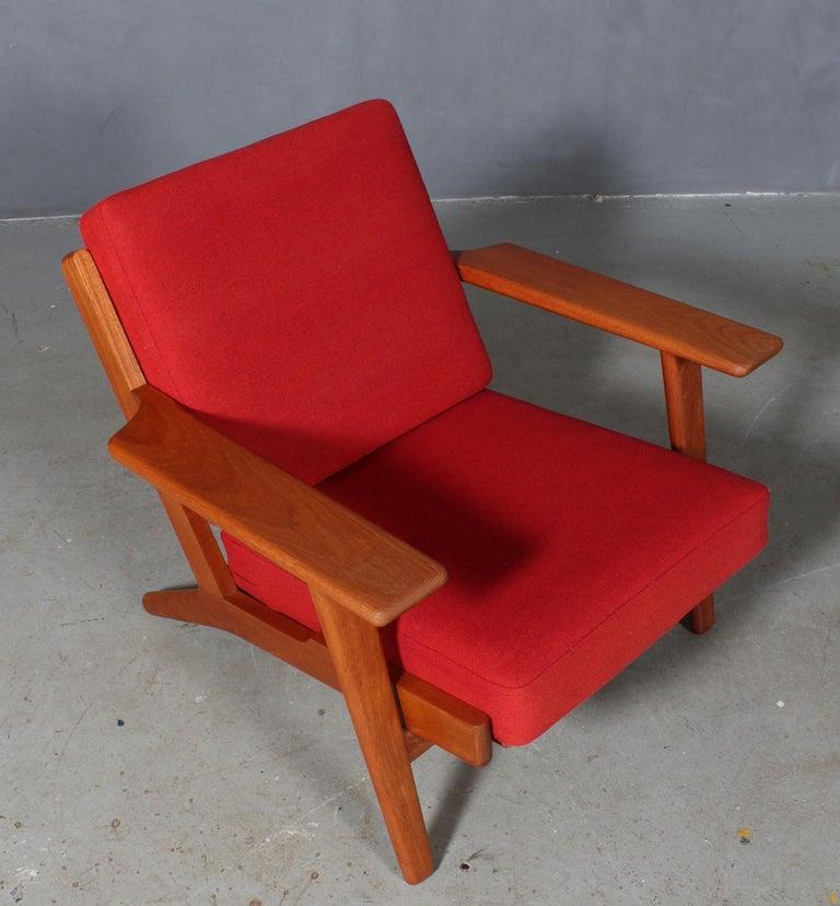 Hans J. Wegner lounge chair made of solid teak.  Original Epeda cushions, original upholstered with Hallingdal wool from Kvadrat.  Model 290, made by GETAMA.
