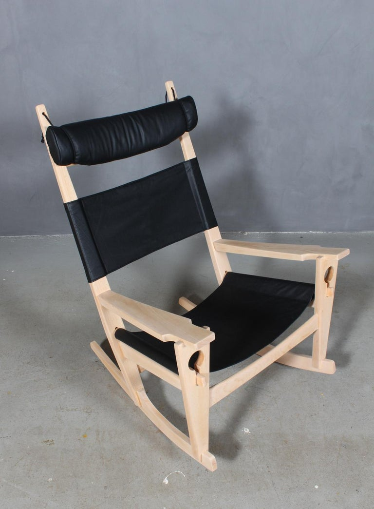 Hans J. Wegner lounge chair / rocking chair new upholstered with black aniline leather.