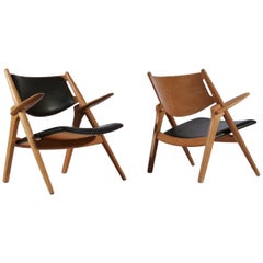 "Hans J. Wegner Lounge Chairs Model ""Sawbuck"" in Oak and Dark Green Leather"