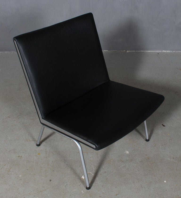 Hans J. Wegner lufthavnsttole designed for Kastrup Airport. New upholstered with black aniline leather.  Base and sides in steel.  Model AP40, made by AP stolen.