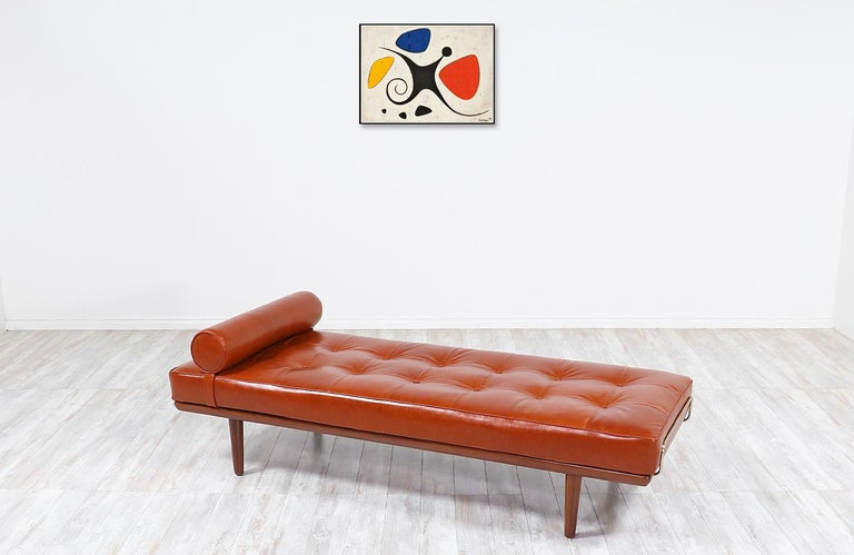 One of the most luxurious and comfortable daybeds from Denmark is this iconic model GE19 designed by architect Hans J. Wegner in collaboration with the famous workshop of GETAMA in 1956. It features an expertly crafted Italian cognac leather