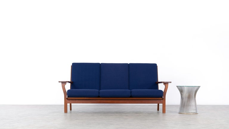 Here you have the opportunity to purchase an extremely rare 3seater sofa by Hans J. Wegner, designed in 1956 for GETAMA in Denmark.  The stamped and handcrafted frame is made of teak.  GETAMA still produces many of Wegner's designs today, but not