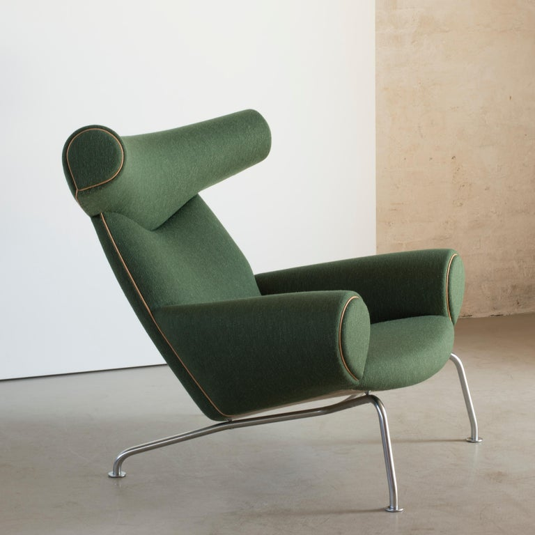 Hans J. Wegner 'Ox-chair' model AP-46. Easy chair with tubular steel frame. Sides, seat and back upholstred with green wool with natural leather edgings. Executed by AP-Stolen, Copenhagen, Denmark.