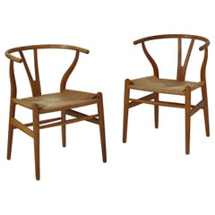 Hans J. Wegner Pair of Early Stamped Carl Hansen & Sons Wishbone Chairs, 1950s