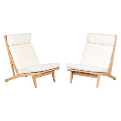 Hans J. Wegner Pair of High Lounge Chairs GE 375 of Oak and Wool by GETAMA 1970s