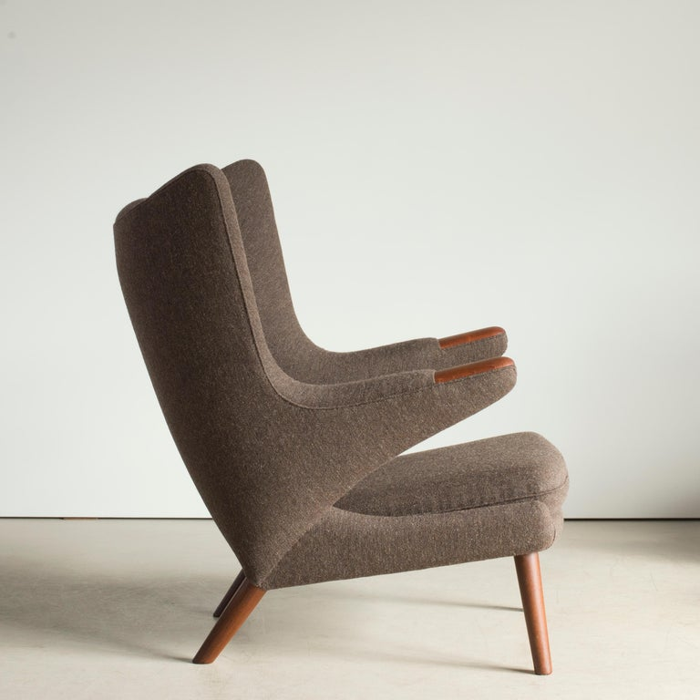 Hans J. Wegner Papa Bear chair model with Teak nails and legs. Upholstered with brown wool. Executed by A.P. Stolen, Copenhagen, Denmark.