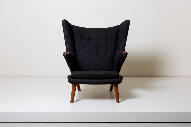 Hans J. Wegner Papa Bear chair model with Teak nails and legs. Upholstered win black fabric. Needs to be upholstered.
