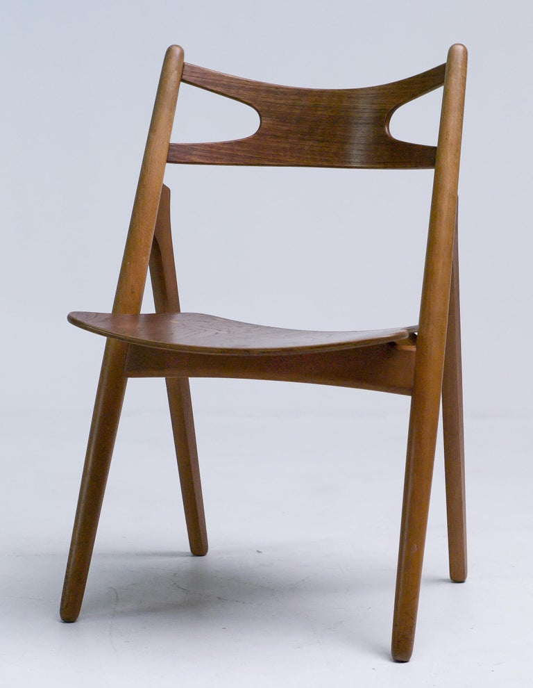 Hans J. Wegner for Carl Hansen & Søn, set of four 'Sawbuck' CH29 chairs, teak, Denmark, 1952.  This set of four chairs is designed by Hans J. Wegner for Carl Hansen.  This is the most desirable version with visible seat construction. The table is