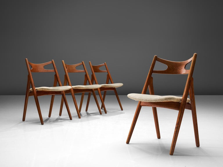 Hans J. Wegner for Carl Hansen & Søn, set of 2 'Sawbuck' CH29 chairs, teak, Denmark, 1952.  This set of chairs is designed by Hans J. Wegner for Carl Hansen. This chair holds a very strong construction even though it has a simplistic design. The