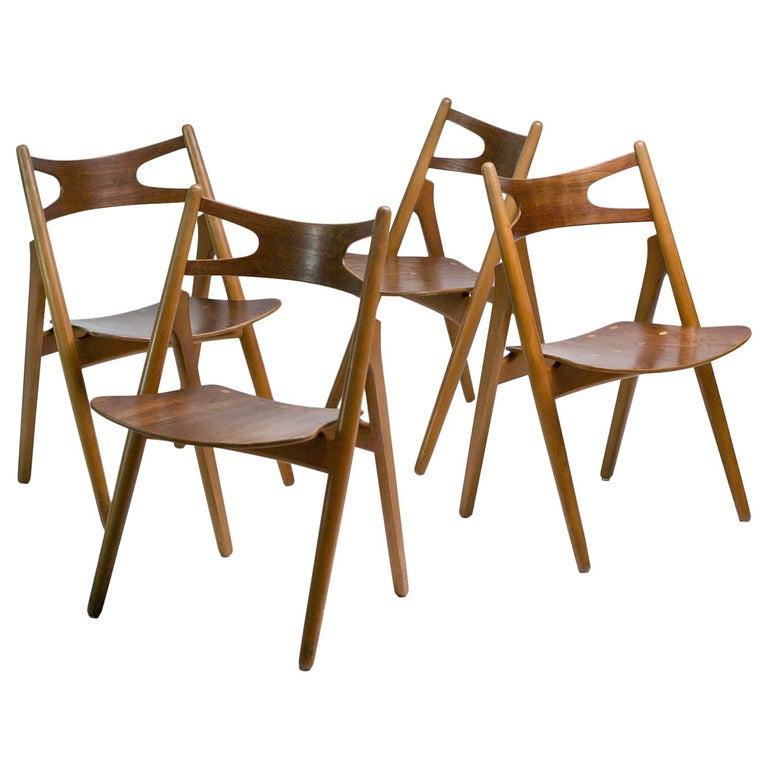 Hans J. Wegner Set of Four Sawbuck Chairs For Sale