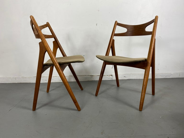 Hans J. Wegner for Carl Hansen & Søn, set of four 'Sawbuck' CH29 chairs, oak, Denmark, 1952. This set of four chairs is designed by Hans J. Wegner for Carl Hansen. Upholstered seats, fabric removed from one seat to show construction. Nice original