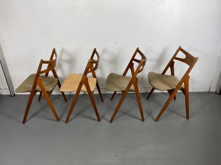 Mid-20th Century Hans J. Wegner Set of Four Sawbuck Chairs, Early Set in Oak, circa 1952, Denmark For Sale